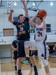 Lakeview's  Cooper Grosteffon goes for the hoop during