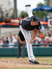 Tigers pitcher Justin Wilson (38) throws a pitch during the fourth inning of the Tigers' 11-6 exhibition loss to the Phillies Tuesday in Lakeland, Fla.