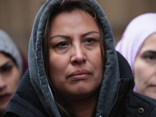Francisca Lino listens as Rep. Luis Gutierrez, D-Ill.,