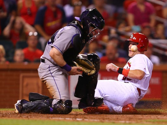 Harrison Bader #48 of the St. Louis Cardinals scores