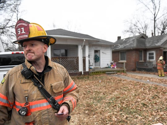 Evansville Fire Investigator Eric Eifert talks to the media at the scene of a fatal fire at 821 Taylor Avenue Sunday, January 7, 2018.