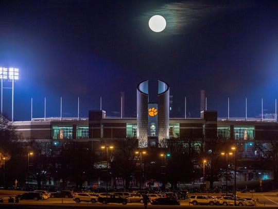 The moon rises with the Clemson Memorial Stadium Oculus