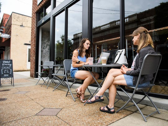 Rebecca Carter and Diane Bartel sit outside Barista