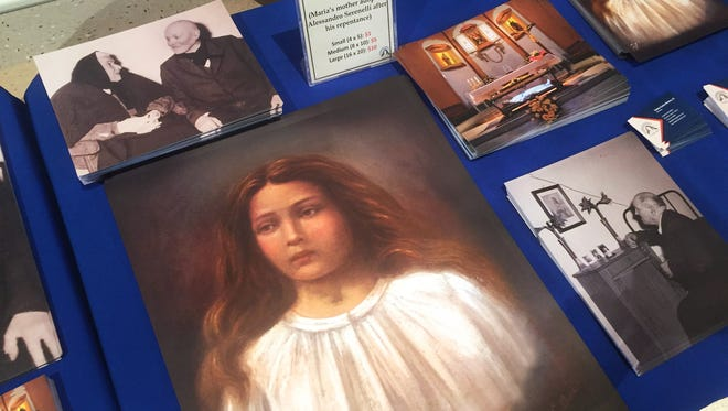 A painting of St. Maria Goretti, the Catholic Church's youngest saint, is shown at the souvenir table, where some photos and books were being sold on Tuesday, Oct. 20, 2015 as thousands of faithful came to St. Maria Goretti Church, 17102 Spring Mill Road, Westfield, to view remains and relics of the saint. It is the only stop in Indiana for the national tour that started in September and will conclude in Oklahoma before the saint's remains are returned to Italy. A movie was viewed and souvenir photos and books for sale. Viewing was from 11 a.m. to 11 p.m.