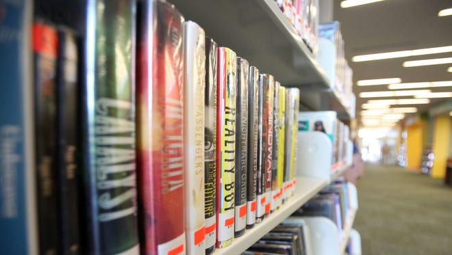 Fiction books are pictured at the East Regional Branch of the Lafayette Public Library, which opened in 2015 in Youngsville.