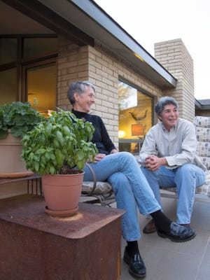 Jane and Mandy, owners of the Brady residence, relax on their patio in Carefree.