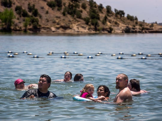 Community members enjoy a swim, Monday at Farmington Lake.