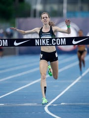 Molly Huddle runs to victory in the women's 10,000