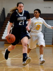 Senior forward Abbey Powell (21) led Farmington in both points and rebounds at Ferndale on Tuesday.