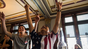 From left, The Gryphon restaurant manager Niall McMahon celebrates with co-worker Marco Loyoal at the end of President Donald Trump's speech on Friday, Jan. 20, 2017. The two men, who are both gay, have complicated political views. McMahon has fully supported Trump even before the primaries and likes Trump's focus of the economy while Loyola wrote in Sanders' name in the general election, but says that any option is better than Hillary Clinton.