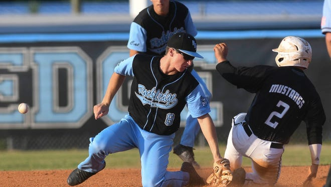 R.J. Diaz of Merritt Island beats the throw to Rockledge's Brett Parrish at second base during a game.