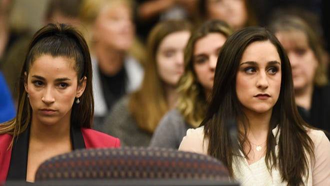 Olympic gold medalists Aly Raisman, left, and Jordyn Wieber sit in Circuit Judge Rosemarie Aquilina's courtroom Friday, Jan. 19, 2018, during the fourth day of the sentencing hearing for former sports medicine doctor Larry Nassar, who pleaded guilty to seven counts of sexual assault in Ingham County, and three in Eaton County.