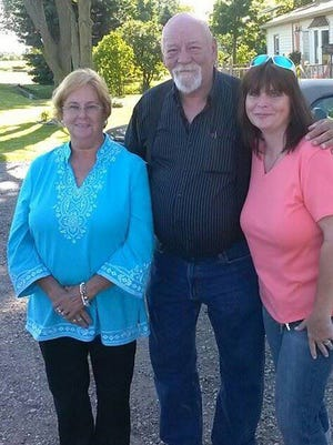 Howell business owner Kim Goddard, right, with her mother, Joyce Tripp, and her father, Ken Abaere.