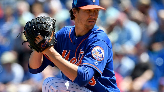 Jacob deGrom prepares to throw a pitch Friday against the Orioles.