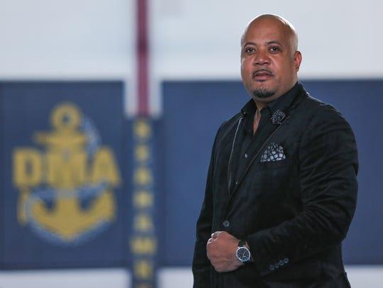Kenneth Gatson wears Lucky Brand jeans; a black J.Ferrar