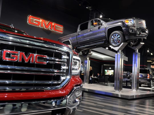 GMC trucks are displayed Tuesday, Jan. 12, during the