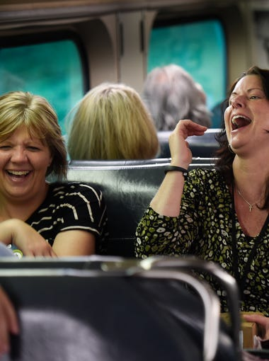 Gina Naylor and Nikki Brown share a laugh on the the Music City Star during their afternoon commute home after work Thursday, Sept. 14, 2017 in Nashville, Tenn.