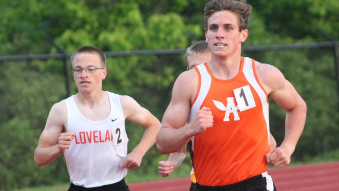 Anderson junior Joe Ingram sets the pace in the 3,200 meters and went on to set a meet record. Loveland's Caleb Davis, left, was second.