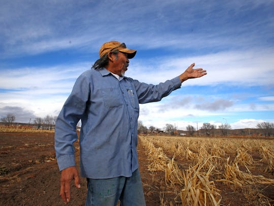 Earl Yazzie talks about the effects of the Gold King Mine spill on his farm Dec. 23, 2015, in Shiprock.