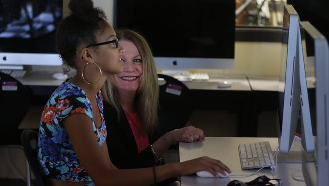 2016 file photo: Rochester City School District Superintendent Barbara Deane-Williams visits Edison Tech campus and its summer bridge programs for incoming freshman. She speaks and laughs briefly with Jasmine Cruz, who is taking a Career Technical Education Exploratory class in digital media.