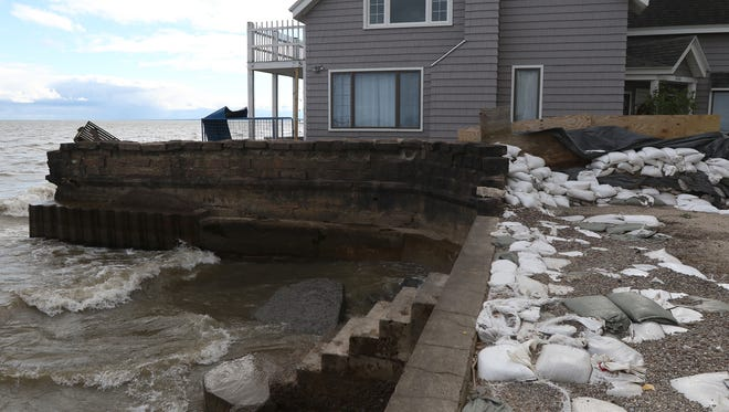 At one point during the spring an inflatable dam was placed on top of the wall to keep the water from flooding nearby homes and Edgemere Drive.