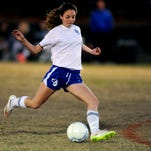 Sacred Heart's Jessica Hyde (4) kicks the ball to score a goal Tuesday during a game against Cathedral at San Antonio Field in Hattiesburg.