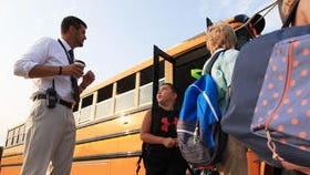 West Clark Superintendent Chad Schenck greets students getting off of buses outside of Silver Creek Elementary School.