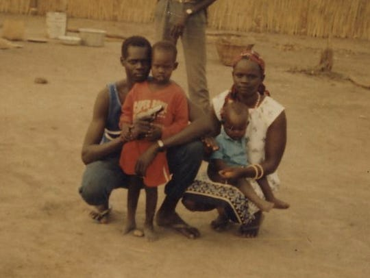 Back in Sudan, from left: Dut Jok, Dau Jok, Peter Jok,