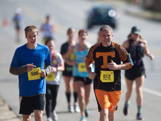 Luke Eakes, left, and Jeremy Ezell on mile 17 of the
