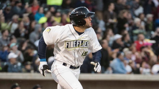 Tim Tebow watches his home run in his first at-bat.