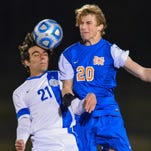 Madison Central's Luke Comfort (20) heads a ball against Ocean Springs' Kyle Hillyard (21) during the MHSAA Soccer State 6A Championship held in Clinton Saturday February 6th 2016.