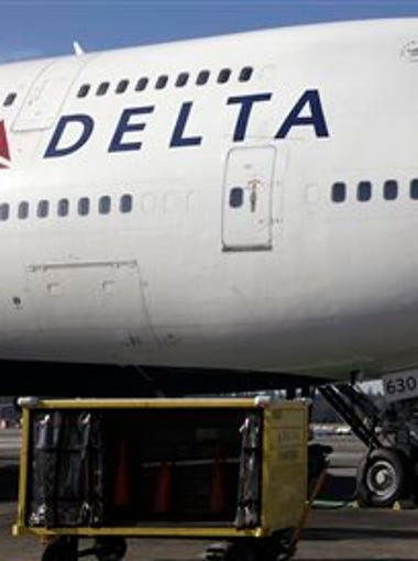 In this Oct. 9, 2012 file photo, Delta Air Lines 747-400