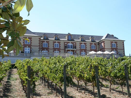 Vine rows ascend to the terrace of the château at Domaine Carneros in the southern Napa Valley in this image from 2015. The château is modeled after the 18th century original in Champagne, France.