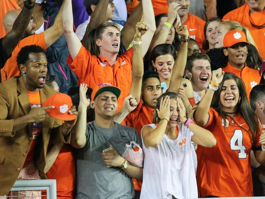 Clemson fans celebrate a 37-34 win over Florida State after the game on Saturday October 29 at Doak Campbell Stadium in Tallahassee, Florida.