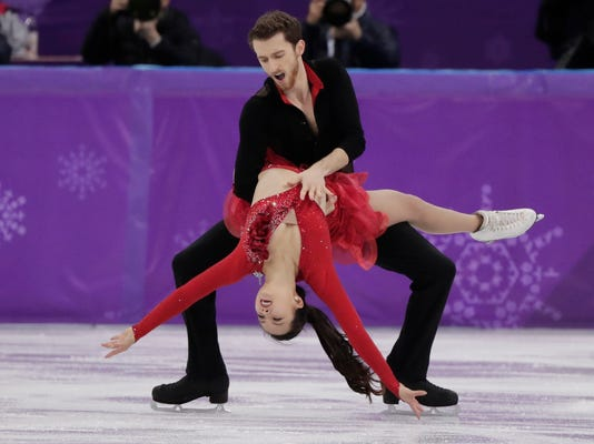 Yura Min and Alexander Gamelin of South Korea perform during the ice dance, short dance figure skating in the Gangneung Ice Arena at the 2018 Winter Olympics in Gangneung, South Korea, Monday, Feb. 19, 2018. (AP Photo/Julie Jacobson)
