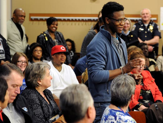 "Keenan Rhodes, 18, speaks as a youth in attendance during a ""community conversation"" hosted by the Department of Public Safety inside the Riley Meeting Room at the Indianapolis Public Library, Thursday, March 20, 2014, in Indianapolis."
