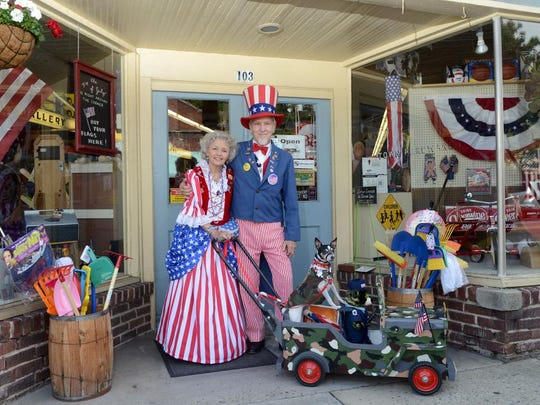 Mr. and Mrs. Uncle Sam, aka Bobbie and Gene Carnell, stand with their dog Scooter at Town Hardware in downtown Black Mountain Friday.