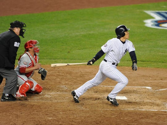 Yankees' Hideki Matsui smacking a two-RBI double in