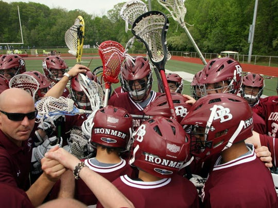 From 2009: Then-freshman lacrosse coach Brian McAleer, left, and Don Bosco lacrosse players gather for a prayer before playing the first game at the First Annual Connor Corish Memorial Freshman Lacrosse Tournament at Don Bosco High School in Ramsey.