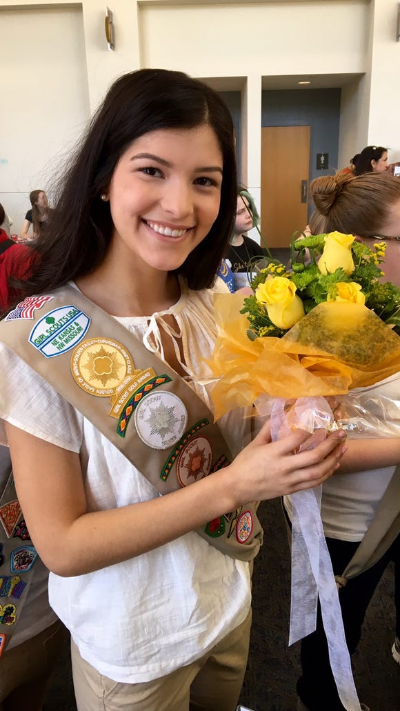 She's also a Girl Scout! Here, Sophia celebrates earning
