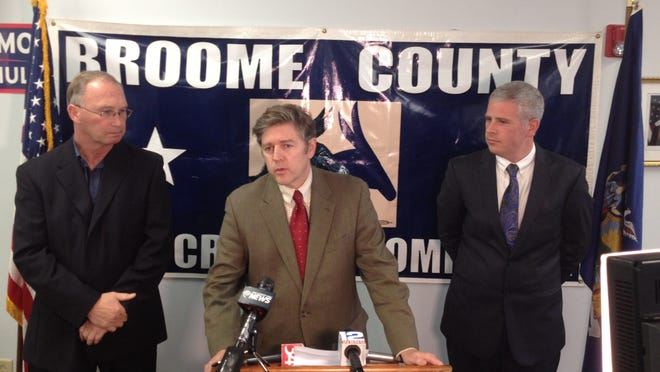 Daniel D. Reynolds, center, resigned from the Broome County Legislature to become the Democratic Election Commissioner.