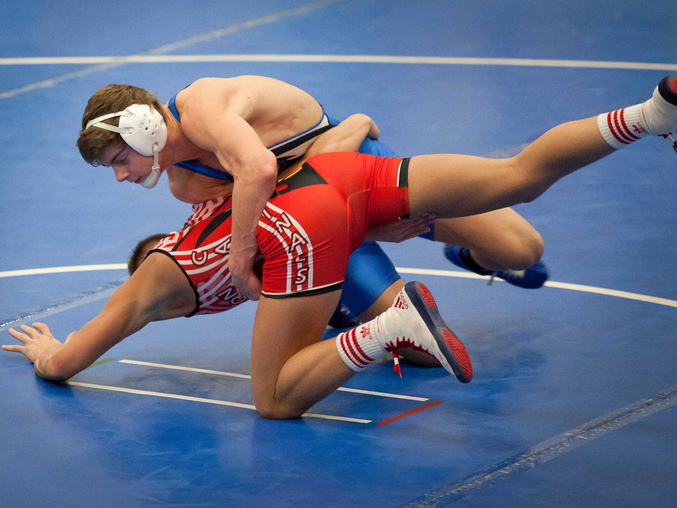 Cros-Lex's Colin Lieber wrestles Millington's Chandler Sweeney during a Division 3 wrestling meet Wednesday, Feb. 11, 2015 at Croswell-Lexington High School.