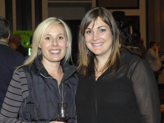 Ashley Brune, left, and Tracie Barnthouse attend the