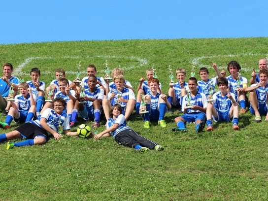 Brockport Blizzards BU14 team after winning the 2014 Niagara Pioneer Soccer Tournament. photo provided by Paige Pye