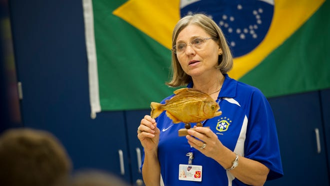 Family and consumer science teacher Susan Walters, of Newburgh, shows her class a mounted piranha during Brazil day at Castle High School in Newburgh. Walters lived in Brazil for 16 years and will hold the special event for her classes each year around Sept. 7, Brazil's independence day.