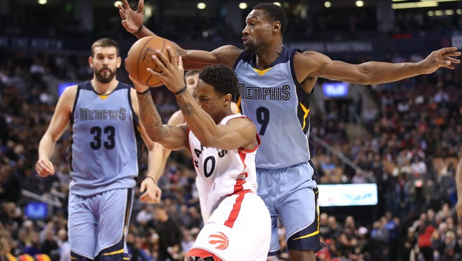 "Toronto Raptors guard DeMar DeRozan (10) goes to the basket as Memphis Grizzlies guard Tony Allen (9) defends in a recent game. Allen and the other ""Nasty Nine"" have been defending well for Memphis."