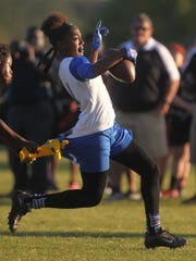 Godby's Armarni Williams runs for a gain before having