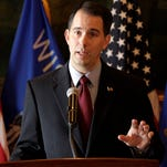 Wisconsin Gov. Scott Walker talks during a news conference at the state Capitol in Madison.