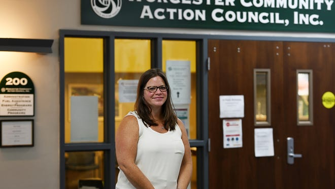 Executive Director Marybeth Campbell stands outside of Worcester Community Action Council in the Denholm Building on Main Street.