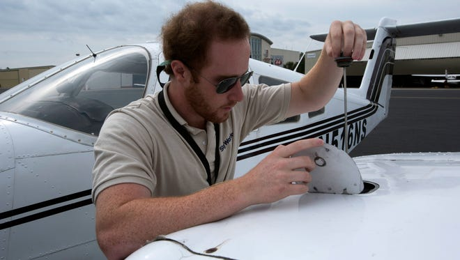 Steven White, a flight instructor for SkyWarriors, Inc., pre-flights an aircraft before taking to the skies with a student aviator, Thursday, April 26, 2018.